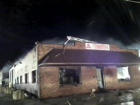 After using handlines and elevated master streams, the fire was placed under control with loss of the building and its contents. Photo: Lt. C. Harris