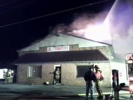 "Crews forced entry and in moments, entered the Side 'A' entrance with an 1 3/4"" Attack Line. Photo: Lt. C. Harris"
